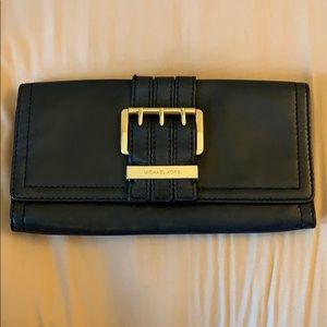 Black and gold Michael Kors clutch